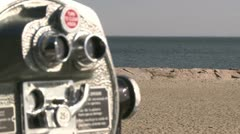 Pay per view binoculars over looking the beach (2 of 3) Stock Footage