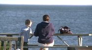 Stock Video Footage of Mother and son sitting at a picnic table overlooking the ocean (2 of 2)