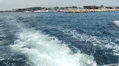 Boat leaves the harbor Stock Footage