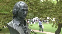 Close up of a monument with a craft fair in background (1 of 2) Stock Footage