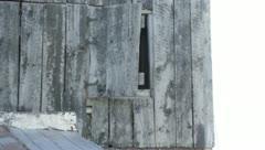 barn door swings in wind - stock footage