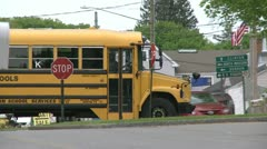 A school bus coming through town on its route  (2 of 2) Stock Footage