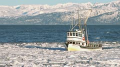 Alaskan Fishing Boat Approaching Icy Harbor 4 Stock Footage