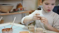Stock Video Footage of group of children modeling with clay in pottery studio