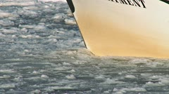 Boat's Bow Pushing through Icy Slushy Waters - stock footage