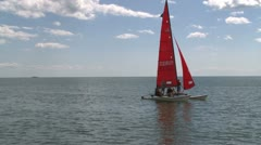Small sailing craft coming in Stock Footage
