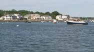 Stock Video Footage of Houses along the water with boats moored in front (1 of 3)