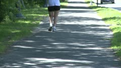 Jogger on path Stock Footage