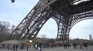 People walking under the Eiffel Tower, Paris Stock Footage