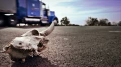 Skull on Highway and Truck Stock Footage