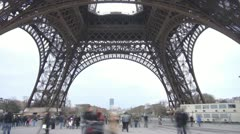 Tourist people walking under Eiffel Tower Paris landmark tourism attraction icon Stock Footage