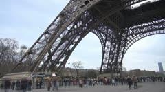 People walking under the Eiffel Tower, Paris Stock Footage