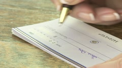 Writing Cheque 01 Stock Footage