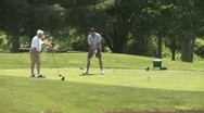 Stock Video Footage of Male golfers tee off (4 of 4)