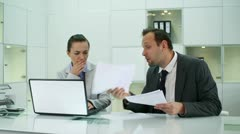 Boss giving reprimand to female worker Stock Footage
