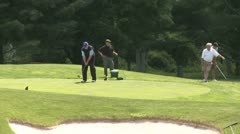 Male golfers tee off (1 of 4) Stock Footage