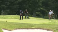 Stock Video Footage of Male golfers tee off (1 of 4)