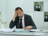 Stock Video Footage of Businessman overwhelmed by too much paperwork