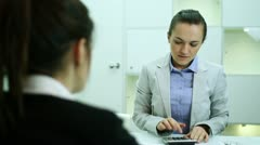 Female client in bank talking with business consultant Stock Footage