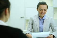 Businesswoman interviewing  female candidate Stock Footage