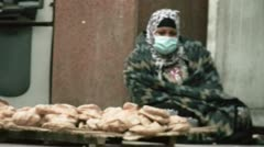 Poor woman and bread Stock Footage