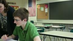 Teacher tutoring student - stock footage