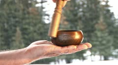 Tibetan Singing Bowl in Hand During Snowfall Stock Footage