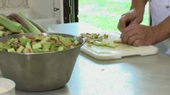 Chef cutting vegetables - stock footage