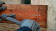 Stock Video Footage of A carpenter fix a nail with his hammer