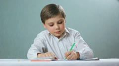 Child , boy draws, left-handed Stock Footage