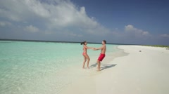 Young couple having fun on deserted island Stock Footage