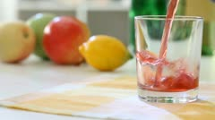 Fruit juice, Fruit juice is poured In the glass Stock Footage