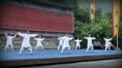 Students of Wudang monastery demonstrate Tai Chi exercises. Editorial use only. - stock footage