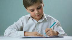 Child , boy draws, left-handed  003 Stock Footage