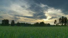 Timelapse of clouds above farm land Stock Footage