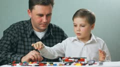Father and son playing in the brick box , child 001  Stock Footage