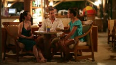 Young people talking in bar Stock Footage
