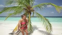young couple at palmtree - stock footage