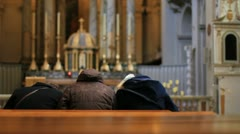 People kneel down and pray in front of the altar. Stock Footage