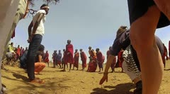 Maasai Chief and people dance and sing with visitors from the outsider Stock Footage