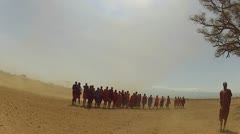 Maasai people dance and sing during sand storm blow by Stock Footage