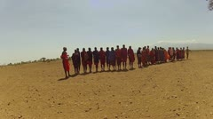 Maasai people dance and sing Stock Footage