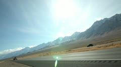SEMI-TRUCK PASS BY MOUNTAIN ROAD. - stock footage