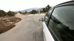 SPEEDY DRIVE DOWN A MOUNTAIN ROAD Stock Footage