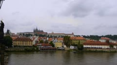 Prague Castle Cloudy with Charles Bridge Statue and Vtlava River, Czech Republic - stock footage