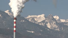 Chimney Pollution With Mountain Background - stock footage