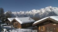 Stock Video Footage of Chalets In Stunning Mountain Scenery