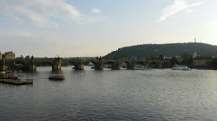 Charles Bridge and river with Petrin Hill in Prague, Czech Republic - stock footage