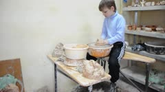 Little girl modeling on pottery wheel and getting teacher's assistance Stock Footage
