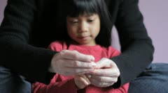 Mother Trimming Little Girls Fingernails Stock Footage